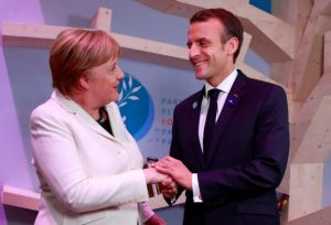 Macron, Merkel defend multilaterism as Trump avoids peace forum